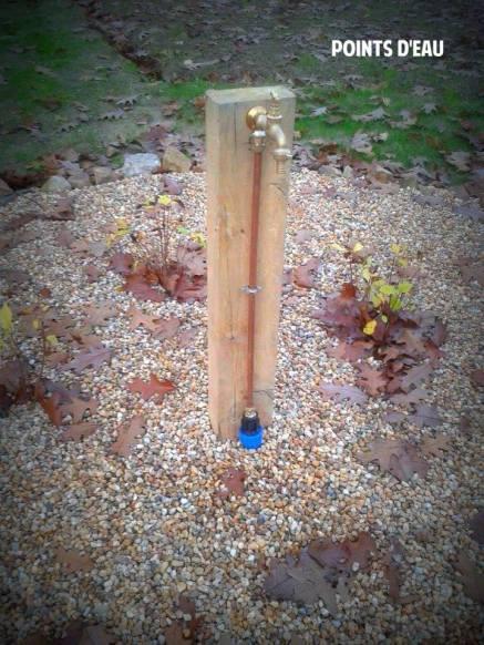 Robinet d'arrivée d'eau dans un jardin